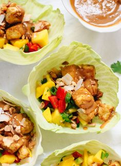 Mango tofu salad wraps with peanut sauce | Expecting vegetarians and meat-lovers at your next gathering? This salad can easily be made with tofu or chicken!