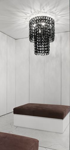 Totally go for it if you doing a new build, treat yourself your hardworking self to a modern chic closet ..just don't care for black chandelier and brown Ottoman could have been more creative with both items and at least make them match