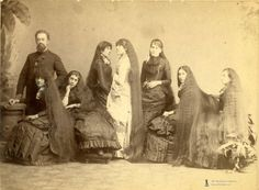 long haired women: I wonder if these were all wives of the man in the photo???