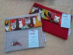 Great Alexander Henry animal print cotton fabric. These are both larger pouches with a pocket inside. The red on is cashmere and the beige is a wool/silk blend.