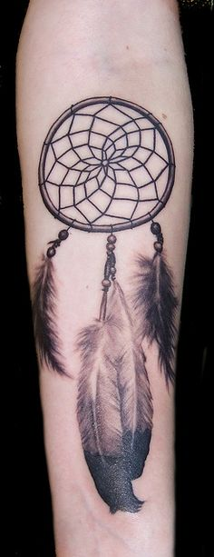 Dream catcher tattoo. Love the feathers