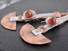 Stainless steel,Copper, Aluminum,Carnelian stone  Earrings. These are light weight and a lot of fun to wear. Could easily become you favorite everyday pair of earrings. So ...