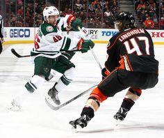 Jared Spurgeon #46 of the Minnesota Wild skates against Hampus Lindholm #47 of the Anaheim Ducks