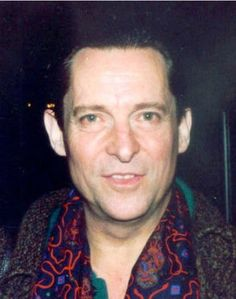 Jeremy being lovable at the camera outside the Wyndham Theatre in 1989.