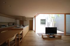 -like that tv stand- Residence in Onohara is a minimalist house located inKanagawa, Japan, designed by Matsunami Hikaririn Architectural. The home is for two couples and their children, located in a dense residential neighborhood. (3)