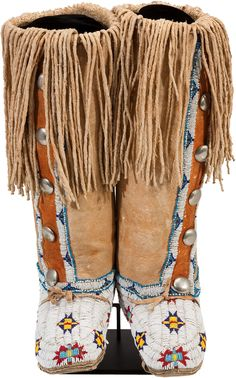 A PAIR OF CHEYENNE BEADED AND FRINGED HIDE BOOT MOCCASINS. | Lot #50024 | Heritage Auctions