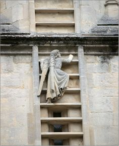 Angel climbing the ladder to heaven. Outside of the abbey in Bath. photo Jacob Ladder