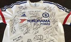 JOHN TERRY presented with signed shirt by Chelsea team-mates after racking up 700 appearances for the club...