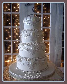 "Lace cut outs, poured sugar jewels, silver dragees, tiny crystal sugared flowers, pearls and luster dust were used to create the cake ""Rachel"""