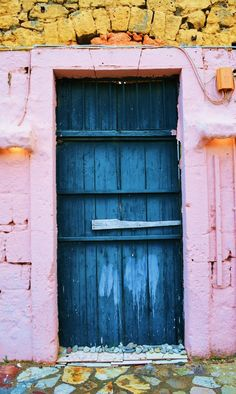 Gialova, Peloponnese, Greece I have never been to Greece, this door and pale pink paint makes me want to go.