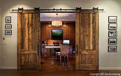 Sliding barn wood doors.  Love this instead of pocket doors.