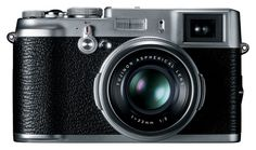 The Fuji FinePix is a point and shoot camera with a DSLR-sized sensor. The Fuji features a lens, which is equivalent to a field of view on a full frame camera. Fuji X100, Instax Mini 8, Fujifilm Instax Mini, Camera Gear, Film Camera, Reflex Camera, Toy Camera, Leica Camera, 1970s