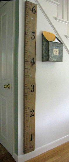 DIY rustic wall ruler. Repurpose an old piece of wood and keep track of your growing family's height.