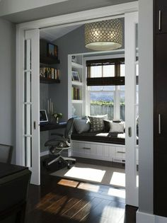dens/libraries/offices - Serena Drum Chandelier gray den office espresso stained chunky floating shelves bamboo shades built-in window seat shelves chocolate brown velvet cushion pillows brown blue pillow gray walls paint color