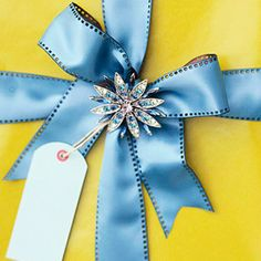 Make your gifts sparkle with the addition of costume jewelry toppers. More bows and trims: http://www.bhg.com/christmas/crafts/creative-christmas-gift-bows-and-trims/