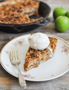 Dutch Apple Pie | This Paleo apple pie is the REAL DEAL! The perfect, buttery grain-free pie crust comes together with a blend of almond flour, coconut flour, and arrowroot starch, then is filled with apples and finished with a simple crumble topping and coconut whipped cream for the perfect holiday dessert. @fedandfit