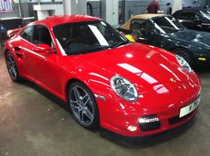 Porsche 997 Turbo (1996 model) in guards red.