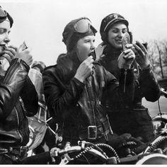 women bikers in leather helmets - vintage.