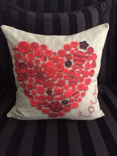 Red Cushion With A Button Heart