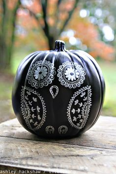 Decorating a chalkboard paint pumpkin with sharpie from MichaelsMakers Lil Blue Boo