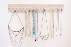 This handmade jewelry organizer attaches to your wall with 3M stickies (included) and is great for necklaces, bracelets, and rings. An additional wood piece snaps onto the organizer with magnets, covering the 3M tabs. Its made of poplar hardwood, which is durable and has a beautiful neutral blonde natural color. The wood is sanded smooth and not stained. Its super easy to install. Simply remove the backing from the 3M tabs and press sticky side to your wall, a door, even a mirror. This…