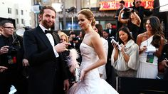 Jennifer Lawrence & Bradley Cooper on the red carpet at the Oscars 2013