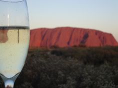 glass of bubbly, the mighty and the sunset. Red Centre, Ayers Rock, Adventure Tours, Rock Art, Geology, Alcoholic Drinks, Bubbles, Australia, Sunset