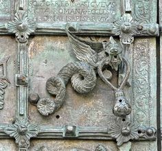 Antique Dragon Door Knocker,..look at that patina and the Latin inscription above the knocker. wow!