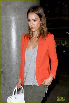 75a6f9da7d6d Jessica Alba livened up her baggy green trousers and white slip ons with a  bright orange jacket. desiree barrameda · travel clothes