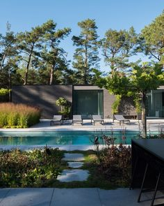 Dark bricks cover this house on the southern tip of Sweden, which Lund-based studio Johan Sundberg Arkitektur arranged around a lush courtyard and swimming pool.