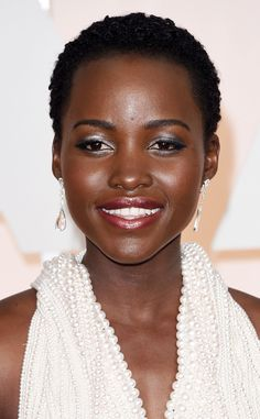 Lupita Nyong'o from Best Beauty Looks at the 2015 Oscars  If you guessed the Oscar winner was going to show up with an ultra-cool eye and lip color, you were correct.