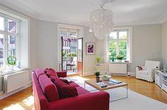 red sofa + greyish neutrals