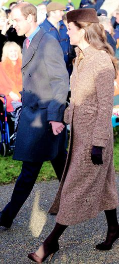 The Duke and Duchess of Cambridge holding hands as they attend the traditional church service for Christmas at Sandringham | Dec.25th 2014