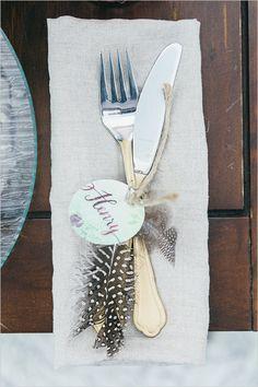 feather embellished flatware