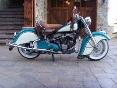 Looks like my Uncle's bike that he conveniently sold before any of the nephews came of age - dang it!   1950 Indian Chief Roadmaster