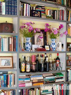 A lovely mantel-like bookcase. Designed by Deirdre Heekin and Caleb Barber. housebeautiful.com #bookshelf #decorating_ideas #bookshelves