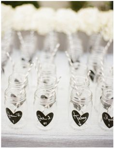 Mason Jars with chalk heart... they could keep these and we could put the hearts on them like your other pin!