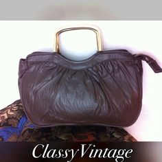 Vintage dark brown leather handbag. 1970's dark brown vintage handbag. Gold tone handles. Top zipper . There is a small side was zippered pocket inside. Pleated in front with a smooth back and bottom. Very good shape. Some very slight marks on handles. 11 long x 7.5 high and 4 inch wide. Made in British Hong Kong Vintage Bags