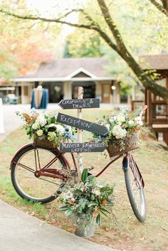 Love this idea- using a bike adorned with flowers and a directional sign for guests!