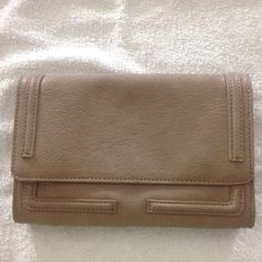 "Taupe Liz Claiborne clutch/cross-body purse Taupe in color, rectangular in shape.  Textured synthetic leather.  Has many pockets/compartments.  Can be carried as a clutch or cross-body - long detachable strap is included (strap is NOT adjustable).  Came with a fob on the strap which will be included inside the purse.  Brand new without tags.  ⚠️ PRICE FIRM ⚠️ Measurements are as follows:  9 3/8"" across, 6 1/8"" tall, 1 ½"" deep, approx. 21 ¼"" strap drop. *Note:  Strap will be folded inside the…"