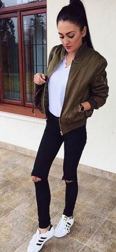 I love this army green bomber with the ripped skinny jeans and Adidas sneakers