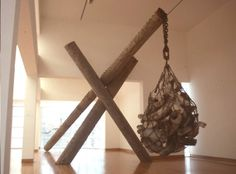 Tusk-Drop 14'x25'x16', Pit-fired Unglazed clay, chain, wood. [Installed 1990 Des Moines Art Center, IA ]