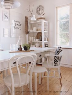 The contrast between the white furniture and the wood floors - that's what I want!