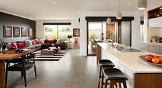 Carlisle Homes - Addison Open Plan Living - like the dark walls floors and wood accents