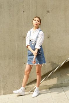 Look how she's styled her dungaree skirt ultra-low so they create a whole new silhouette. Stealing that styling trick.