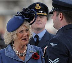 The Duchess of Cornwall, in her role as Honorary Air Commodore of Royal Air Force Leeming, chats to a member of 100 Squadron after presenting a new Squadron Standard at the North Yorkshire base, 2 November 2010.