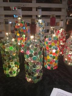 Beautiful, custom made recycled wine bottles have transformed into wine bottle lights. With your choice of colored glass gems -these wine bottle lamps provide wonderful light and sets a very romantic mood. Perfect as a night light or to enhance wine bottl Recycled Wine Bottles, Lighted Wine Bottles, Bottle Lights, Plastic Bottles, Empty Bottles, Altered Bottles, Liquor Bottles, Diy Bottle Lamp, Glass Bottle Crafts