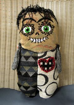 Zeegore the Zombie Doll is made from recycled fabrics from the St. Louis Teachers' Recycle Center.  To see more of my dolls with hand embroidered faces and to snag a free pattern for a doll or face , go to my set here:  www.flickr.com/photos/jacquedavis/sets/72157623853032506/    Best Regards,  Jacque