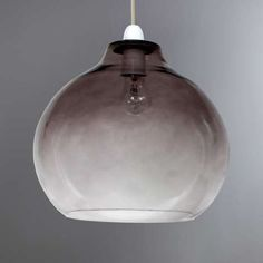 Make a bold impact in any room with this contemporary ceiling pendant by the experts at Hotel, fashioned with smoked black glass with a trendy ombre effect. Thi...