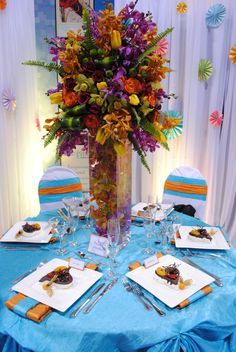 Turquoise with pops of orange. #weddingrentals #weddingdecor #eventrentals #yyceventrentals www.greateventsrentals.com